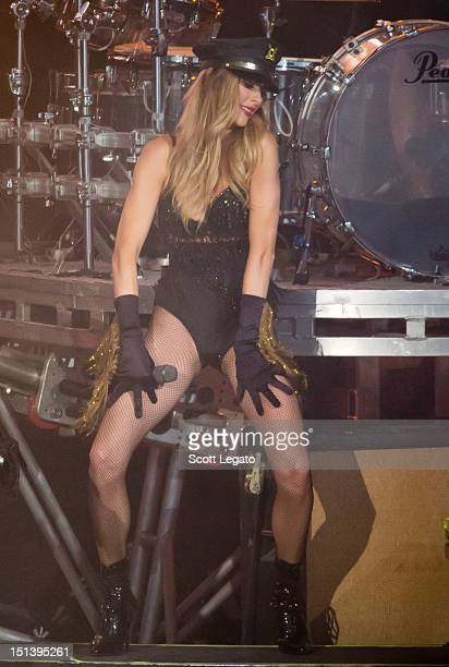 Courtney Bingham dances on stage with Motley Crue during Girls Girls Girls at DTE Energy Center on September 6 2012 in Clarkston Michigan