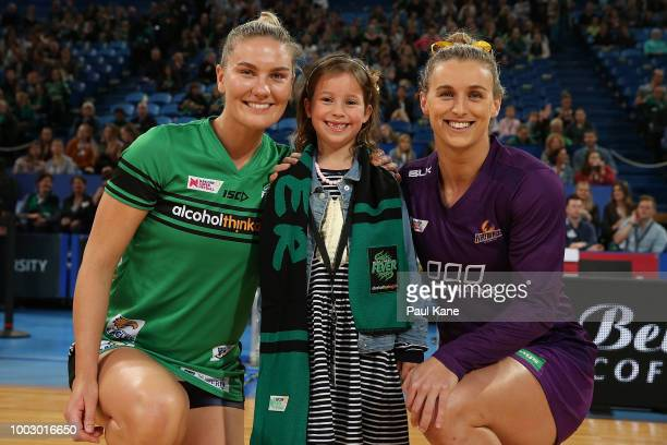 Courtney Bruce of the Fever and Gabi Simpson of the Firebirds pose after the coin toss during the round 12 Super Netball match between the Fever and...