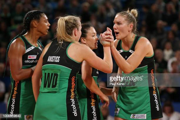 Courtney Bruce of the Fever celebrates high fives with Jessica Anstiss at the half time break during the round 13 Super Netball match between the...