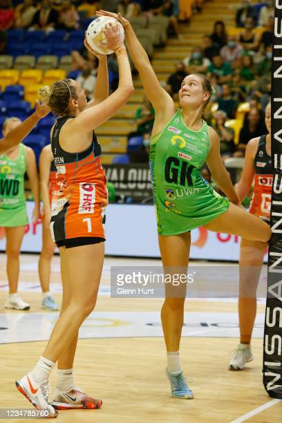 Courtney Bruce of the Fever tries to block the shot of Jo Harten of the Giants during the Preliminary Final Super Netball match between the GWS...