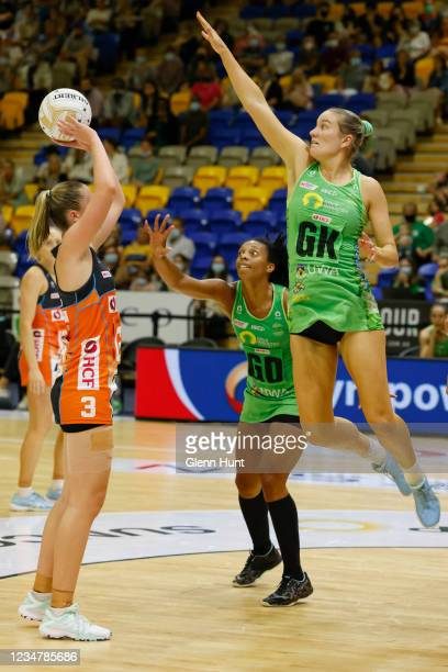Courtney Bruce of the Fever tries to block the shot of Sophie Dwyer of the Giants during the Preliminary Final Super Netball match between the GWS...