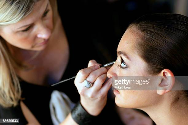 Courtney Chircop has her make-up touched up prior to the ASUS Green Collection Launch at the Overseas Passenger Terminal on November 12, 2008 in...