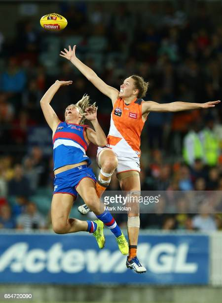 Courtney Clarkson of the Bulldogs and Erin McKinnon of the Giants contest possession during the round seven AFL Women's match between the Greater...