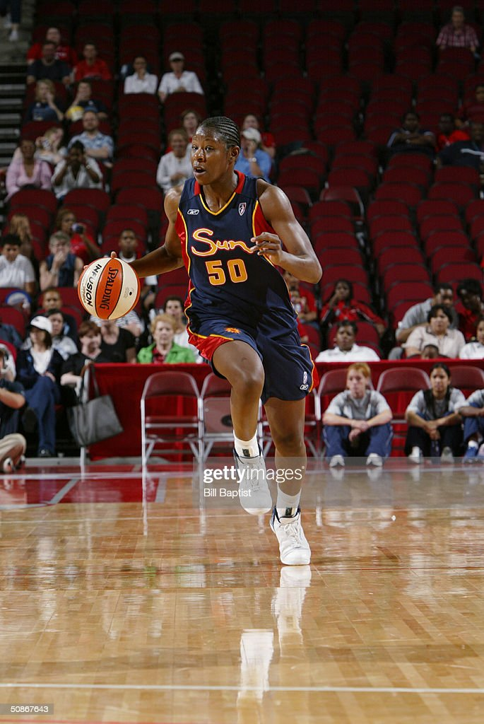 Courtney Coleman #50 of the Connecticut Sun advances the ball upcourt against the Houston Comets during the preseason game at Toyota Center on May 11, 2004 in Houston, Texas. The Comets won 84-71.