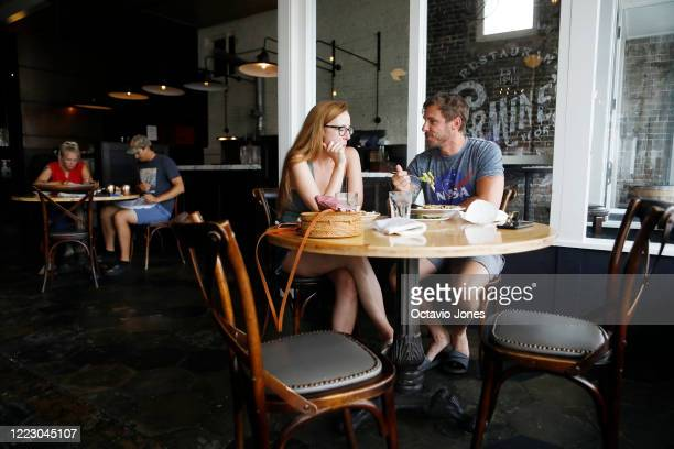 Courtney Conklin and Bill Warham have lunch at Carmines Ybor Italian restaurant on June 26, 2020 in Tampa, Florida. Floridahassuspendedthe...