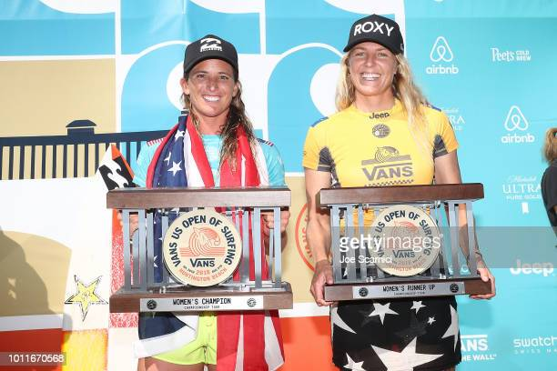 Courtney Conlogue and Stephanie Gilmore pose with their trophies after their final heat at the Vans US Open of Surfing on August 5 2018 in Huntington...