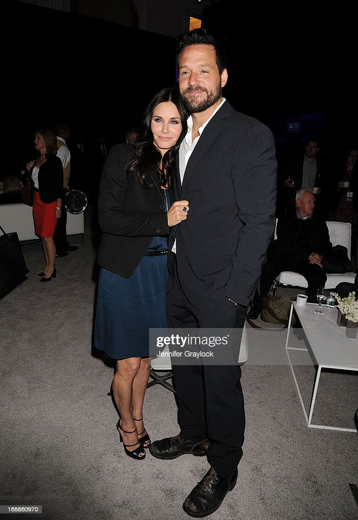 Courtney Cox, Josh Hopkins attend the 2013 TNT/TBS Upfront presentation at Hammerstein Ballroom on May 15, 2013 in New York City.