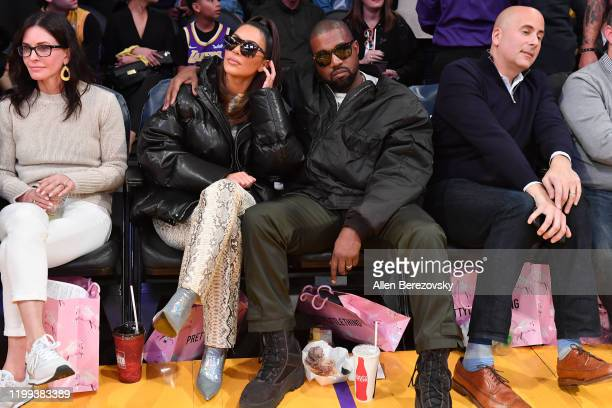 Courtney Cox Kim Kardashian and Kanye West attend a basketball game between the Los Angeles Lakers and the Cleveland Cavaliers at Staples Center on...