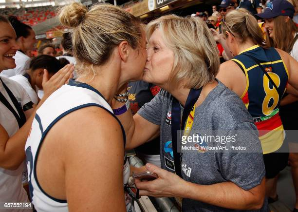 Courtney Cramey of the Crows celebrates with family during the 2017 AFLW Grand Final match between the Brisbane Lions and the Adelaide Crows at...