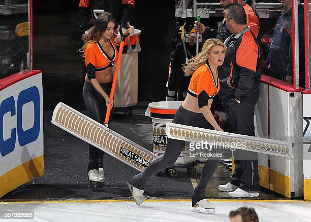 Courtney Crossett and Krista Allysse Cipollone of the Philadelphia Flyers ice girls enter the ice surface during a timeout against the Toronto Maple...