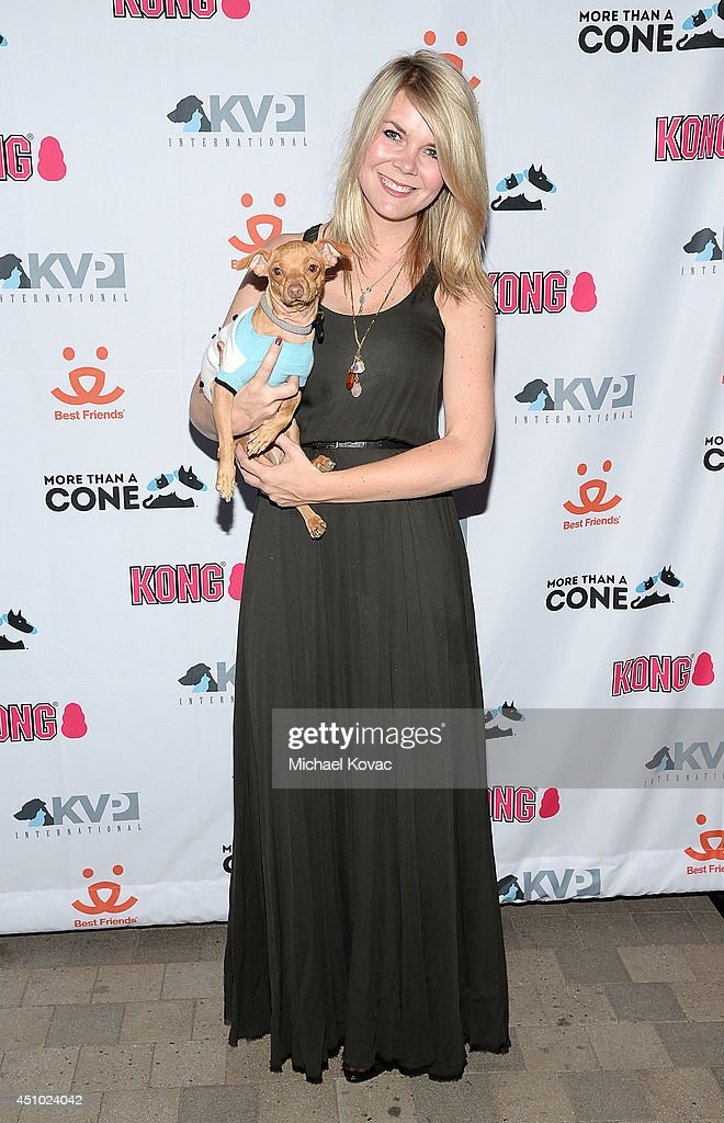 Courtney Dasher with her dog Tuna (aka TunaMeltsMyHeart) enjoys the 'More Than a Cone' art auction and campaign launch benefiting Best Friends Animal Society in Los Angeles where renowned artists re-imagined the 'cone of shame' to raise awareness for animals in need at LA Plaza de Cultura y Artes on June 21, 2014 in Los Angeles, California.