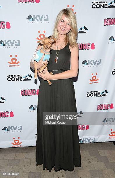 Courtney Dasher with her dog Tuna enjoys the 'More Than a Cone' art auction and campaign launch benefiting Best Friends Animal Society in Los Angeles...