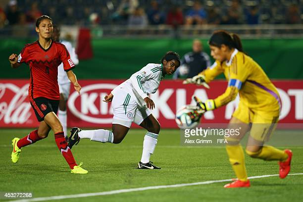 Courtney Dike 8c9 of Nigeria misses a chance against goalkeeper Cecilia Santiago and Paulina Solis of Mexico during the FIFA U20 Women's World Cup...