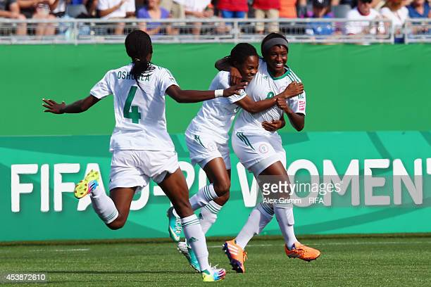 Courtney Dike of Nigeria celebrates her team's first goal with team mates during the FIFA U20 Women's World Cup Canada 2014 Semi Final match between...