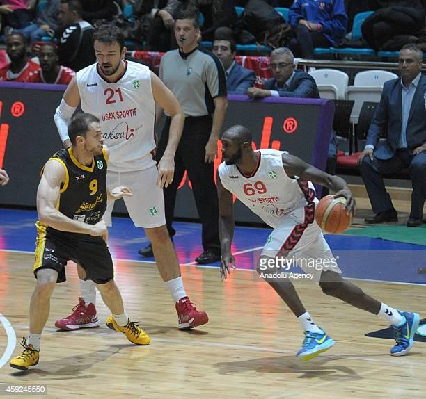 Courtney Fells of Usak Sportif vies with Gintaras Leonavicius of BC Siauliai during FIBA EuroChallenge Group H basketball match between Usak Sportif...