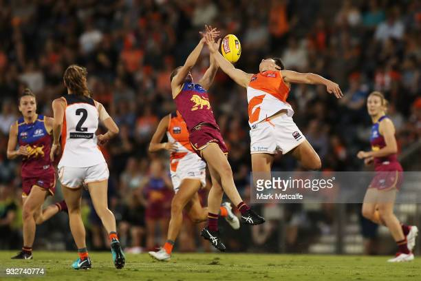 Courtney Gum of the Giants and Nat Exon of the Lions compete for a mark during the round seven AFLW match between the Greater Western Sydney Giants...