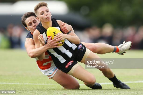 Courtney Gunn of GWS tackles Emma Grant of the Magpies during the round three AFLW match between the Collingwood Magpies and the Greater Western...