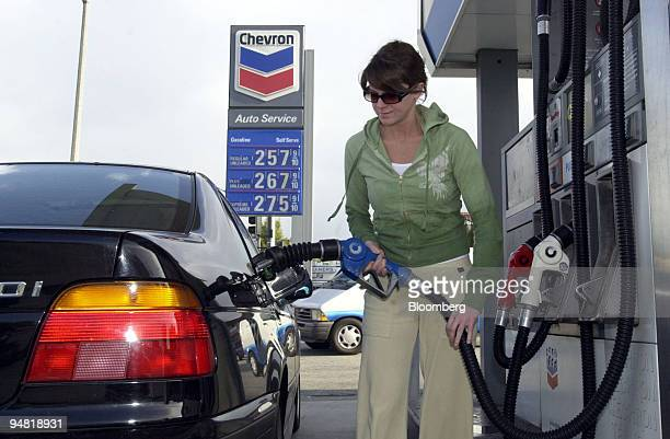 Courtney Henry pumps gas at a Chevron gas station in Pasadena California Monday April 4 2005 Photogrpaher Susan Goldman/Bloomberg News