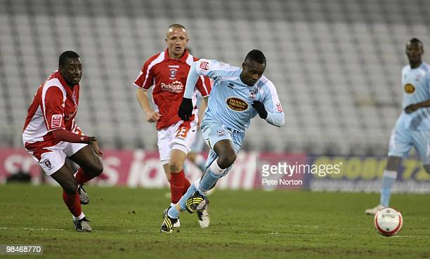 Courtney Herbert of Northampton Town moves away from Pablo Mills of Rotherham United during the Coca Cola League Two Match between Rotherham United...