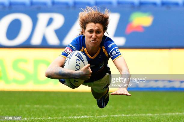 Courtney Hill of Leeds Rhinos scores her teams third try of the match during the Coral Women's Challenge Cup Final between Castleford Tigers and...
