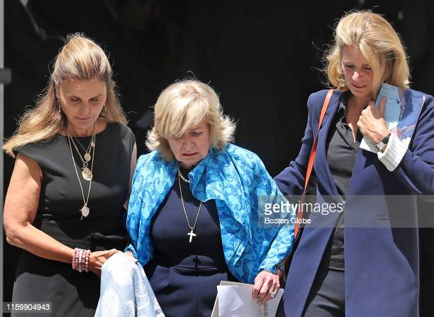 Courtney Kennedy Hill center is helped down the steps of the church by Maria Shriver left and Sydney Lawford McKelvy right after funeral services for...