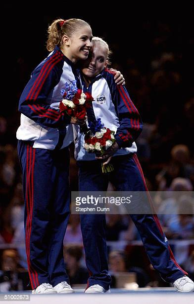 Courtney Kupets hugs Courtney McCool after the two were named to the 2004 US Olympic Team following the Women's finals of the US Gymnastics Olympic...