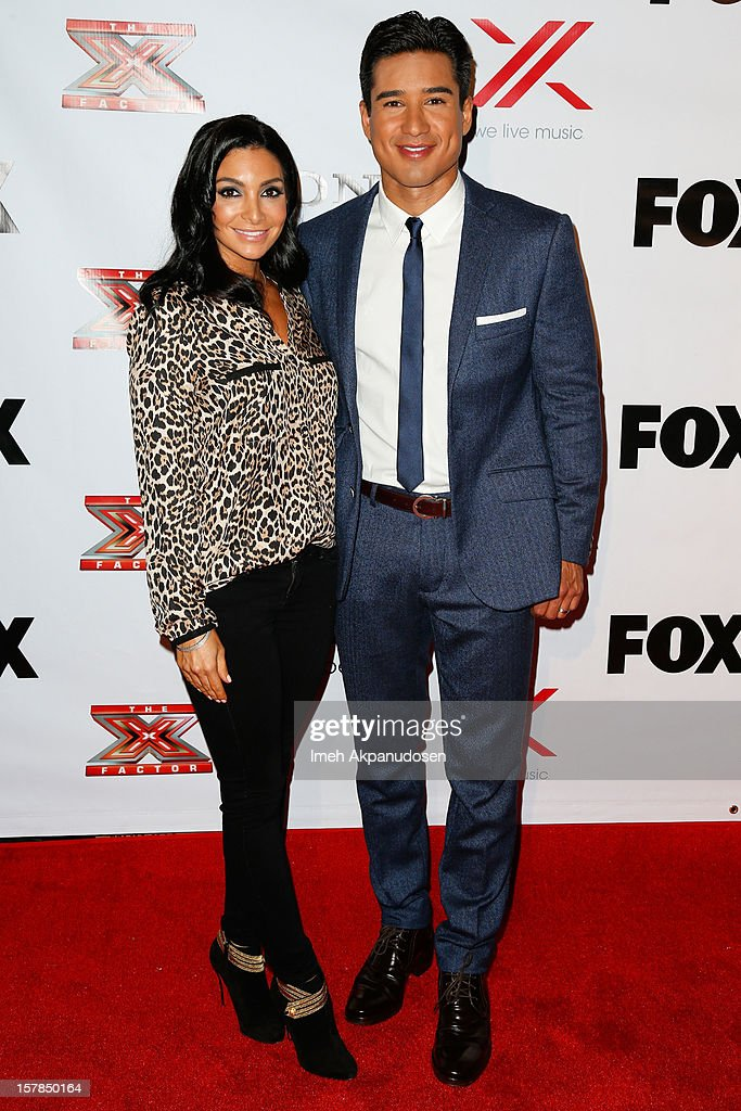 Courtney Laine Mazza (L) and TV personality/actor Mario Lopez attend Fox's 'The X Factor' viewing party at Mixology101 & Planet Dailies on December 6, 2012 in Los Angeles, California.
