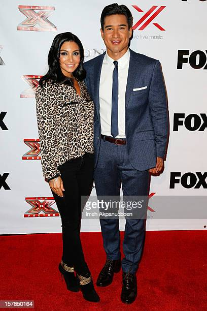 Courtney Laine Mazza and TV personality/actor Mario Lopez attend Fox's 'The X Factor' viewing party at Mixology101 Planet Dailies on December 6 2012...