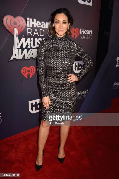 Courtney Laine Mazza arrives at the 2018 iHeartRadio Music Awards which broadcasted live on TBS TNT and truTV at The Forum on March 11 2018 in...