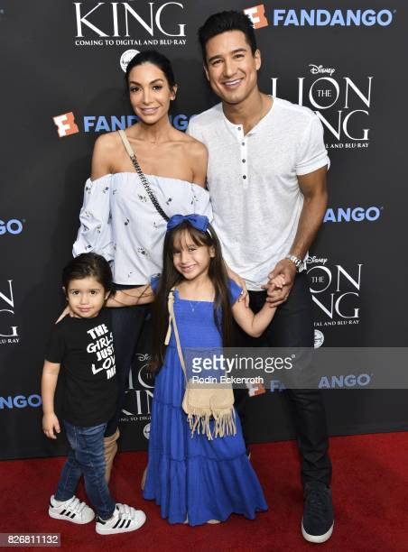 "Courtney Laine Mazza, Mario Lopez, and children Dominic Lopez, and Gia Francesca Lopez attend ""The Lion King"" sing-along screening at The Greek..."