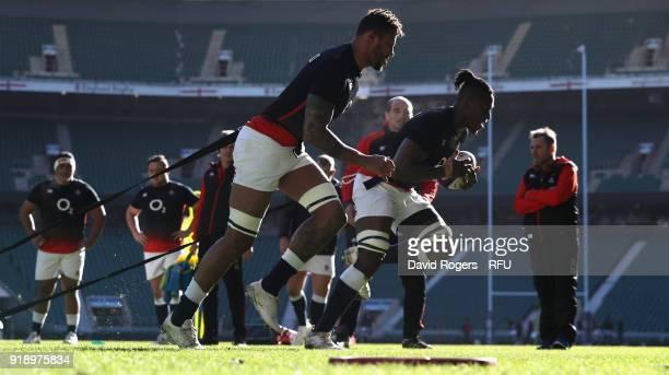 Courtney Lawes and Maro Itoje sprint during the England training session held at Twickenham Stadium on February 16 2018 in Twickenham England