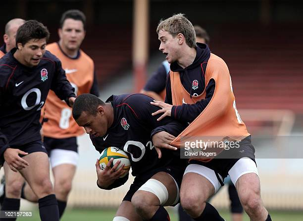 Courtney Lawes moves past Mathew Tait during the England training session at the North Sydney Oval at on June 17 2010 in Sydney Australia
