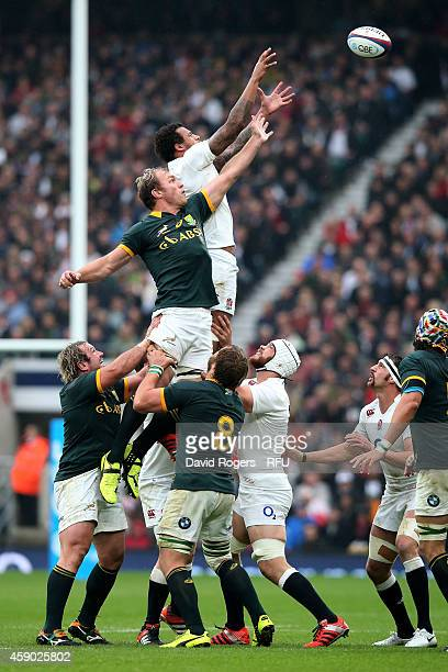 Courtney Lawes of England claims line out ball under pressure from Duane Vermeulen of South Africa during the QBE Intenational match between England...