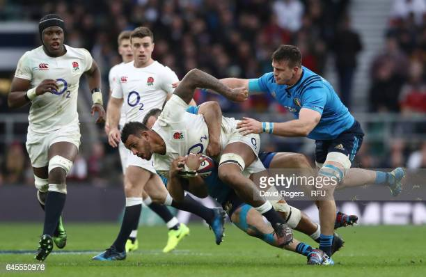 Courtney Lawes of England is hauled down by the italian defence during the RBS Six Nations match between England and Italy at Twickenham Stadium on...