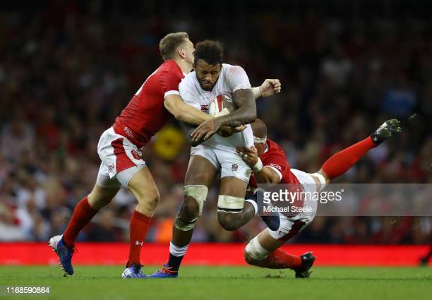 Courtney Lawes of England is tackled by Dan Biggar and Aaron Shingler of Wales during the Under Armour Summer Series match between Wales and England...