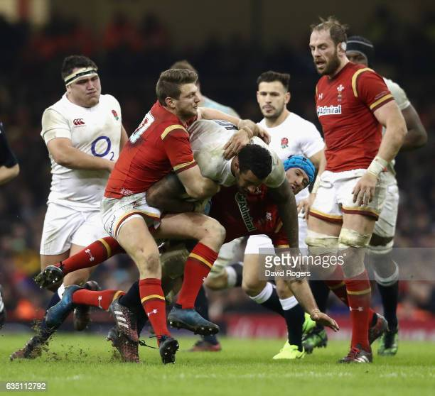 Courtney Lawes of England is tackled by Dan Biggar and Justin Tipuric during the RBS Six Nations match between Wales and England at the Principality...