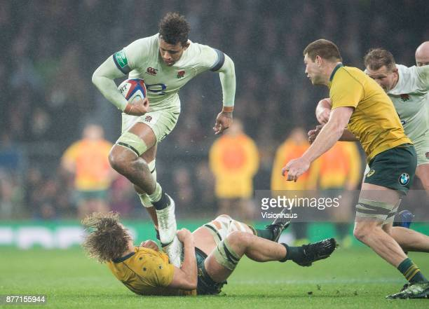 Courtney Lawes of England is tackled by Ned Hanigan of Australia during the Old Mutual Wealth Series autumn international match between England and...