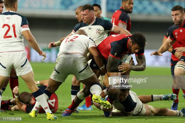 Courtney Lawes of England is tackled by Paul Lasike of USA during the Rugby World Cup 2019 Group C game between England and USA at Kobe Misaki...
