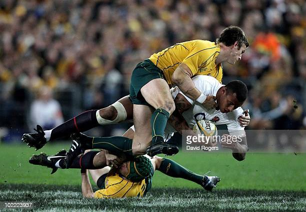 Courtney Lawes of England is tackled by Rob Horne and Matt Giteau during the Cook Cup Test Match between the Australian Wallabies and England at ANZ...