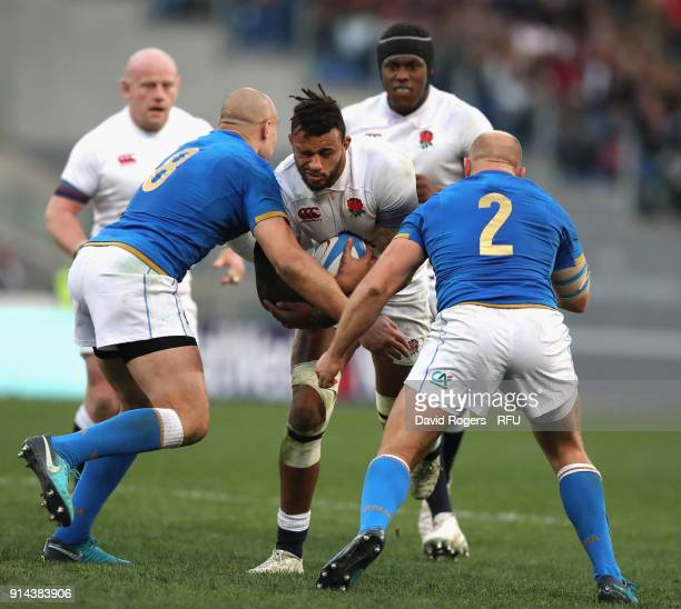 Courtney Lawes of England is tackled by Sergio Parisse and Leonardo Ghiraldini during the NatWest Six Nations match between Italy and England at...
