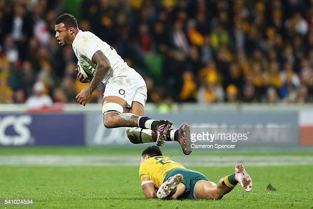 Courtney Lawes of England is tackled during the International Test match between the Australian Wallabies and England at AAMI Park on June 18 2016 in...