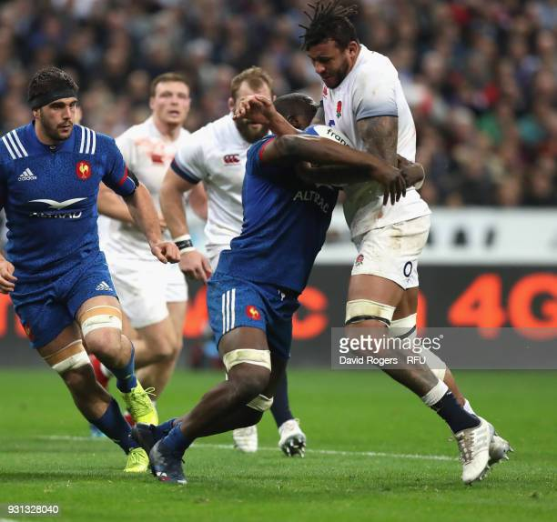 Courtney Lawes of England is tackled during the NatWest Six Nations match between France and England at Stade de France on March 10 2018 in Paris...