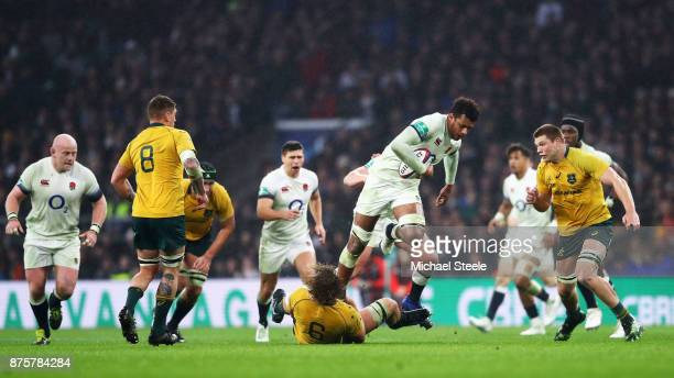 Courtney Lawes of England jumps over Ned Hanigan of Australia during the Old Mutual Wealth Series match between England and Australia at Twickenham...