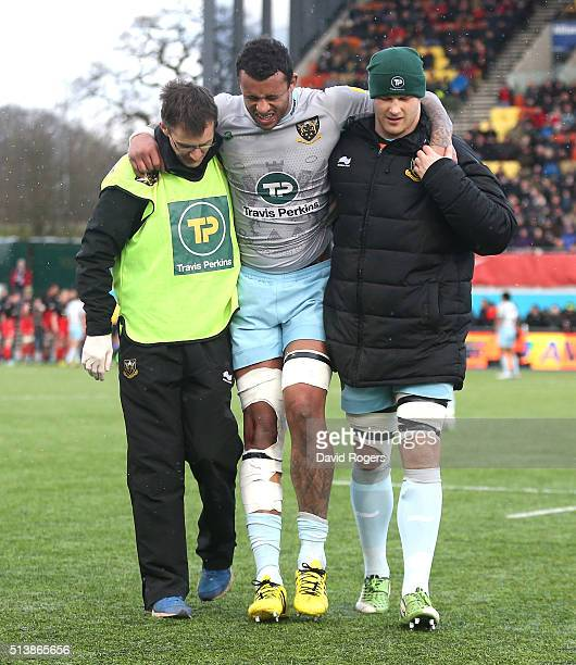 Courtney Lawes of Northampton is carried off the pitch during the Aviva Premiership match between Saracens and Northampton Saints at Allianz Park on...
