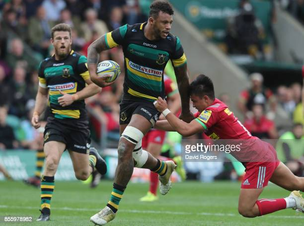 Courtney Lawes of Northampton moves past Marcus Smith during the Aviva Premiership match between Northampton Saints and Harlequins at Franklin's...