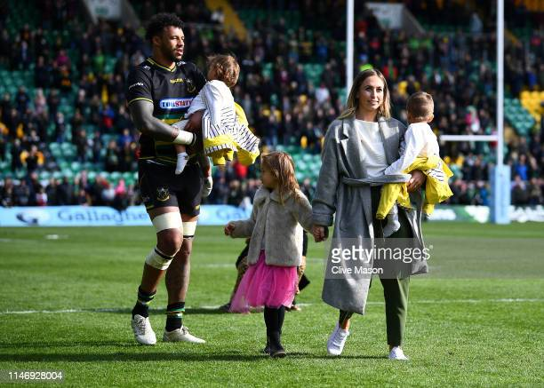 Courtney Lawes of Northampton Saints acknowledges the crowd with his family after the Gallagher Premiership Rugby match between Northampton Saints...