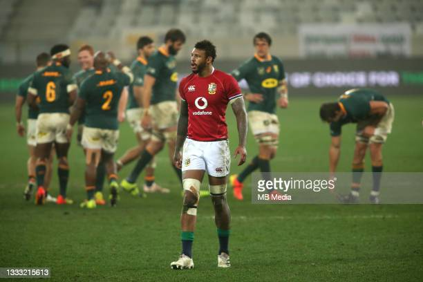 Courtney Lawes of the British & Irish Lions looks dejected as South Africa celebrate in the background during the 3rd Test between South Africa and...