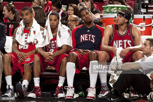 Courtney Lee Devin Harris Sean Williams and Josh Boone of the New Jersey Nets looks on dejected from the bench during the game against the Portland...