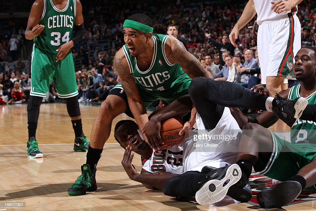 Courtney Lee #11 of the Boston Celtics and Samuel Dalembert #21 of the Milwaukee Bucks battle for a loose ball on November 10, 2012 at the BMO Harris Bradley Center in Milwaukee, Wisconsin.