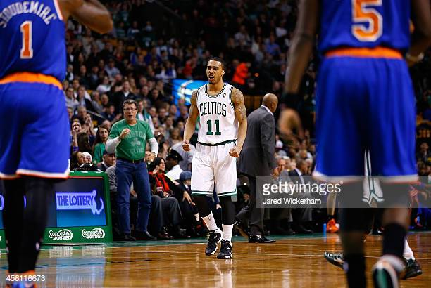 Courtney Lee of the Boston Celtics celebrates a lastsecond shot to end the first quarter against the New York Knicks during the game at TD Garden on...